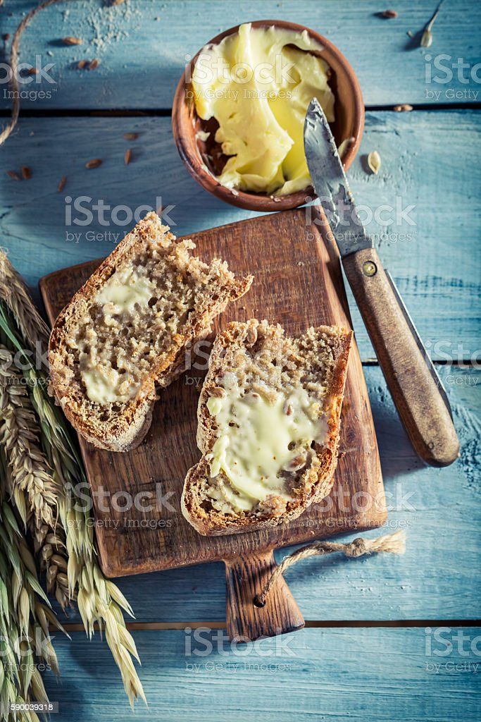Tasty bread with butter for breakfast stock photo