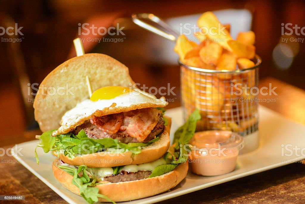 tasty burger with fried egg stock photo