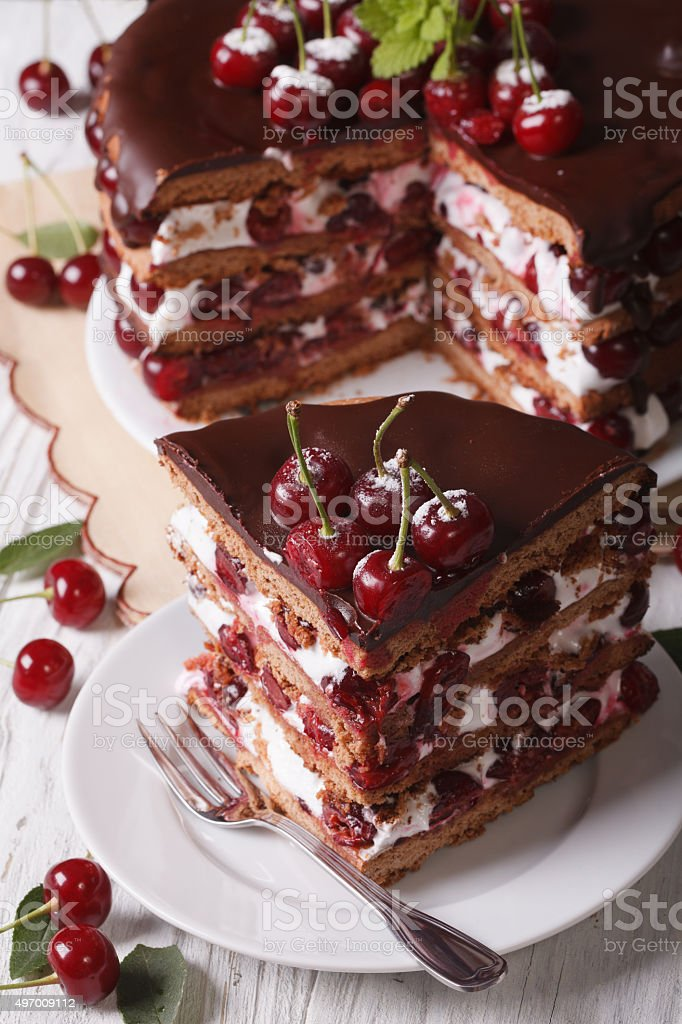 Tasty cherry cake with chocolate and cream vertical top view stock photo