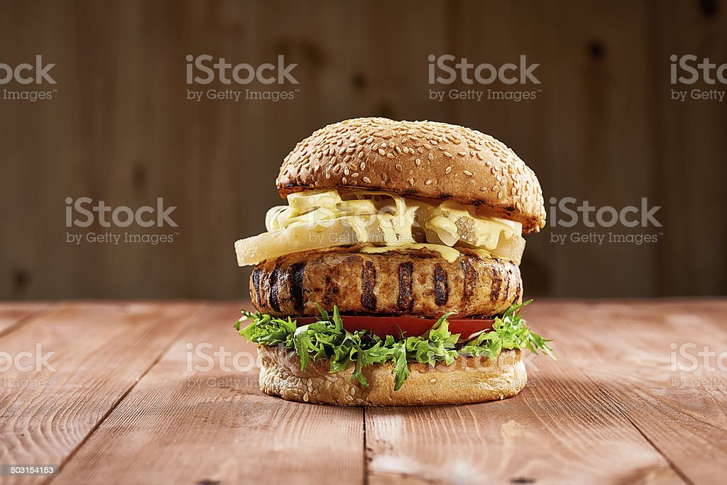Tasty chicken burger with pineapple slices stock photo