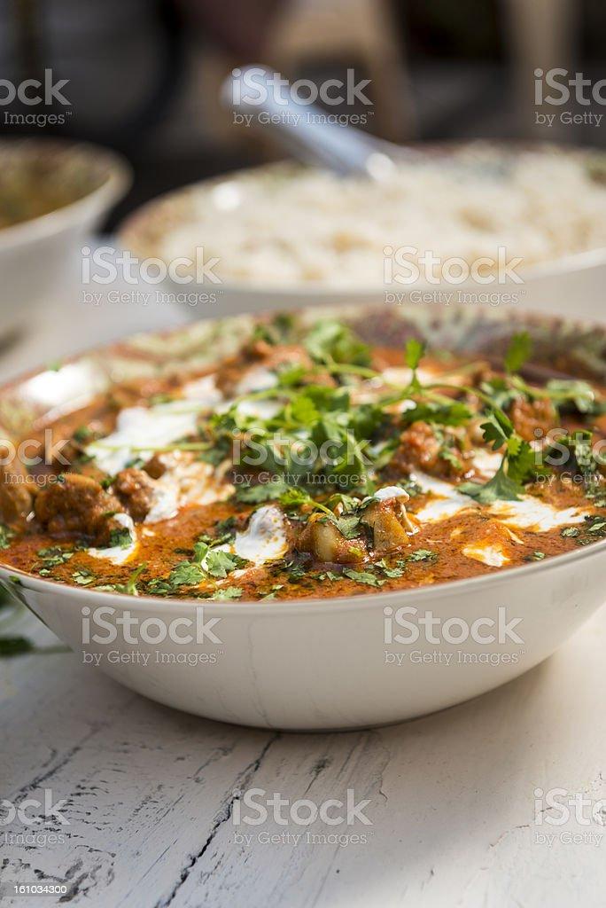 Tasty chicken butter masala on wooden table stock photo
