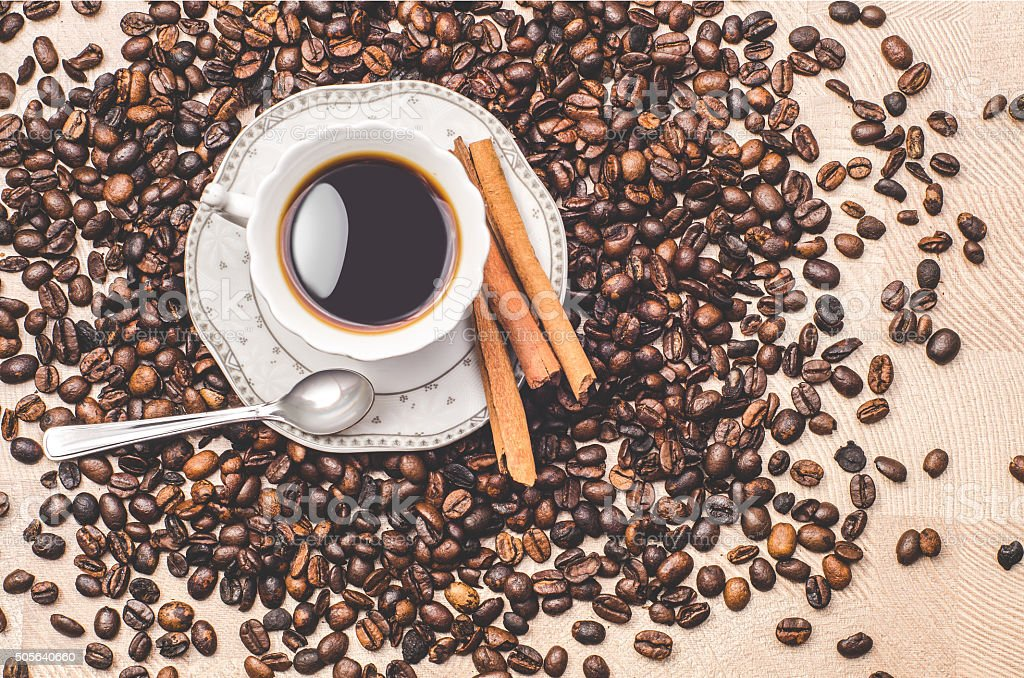 Tasty coffee with roasted beans stock photo