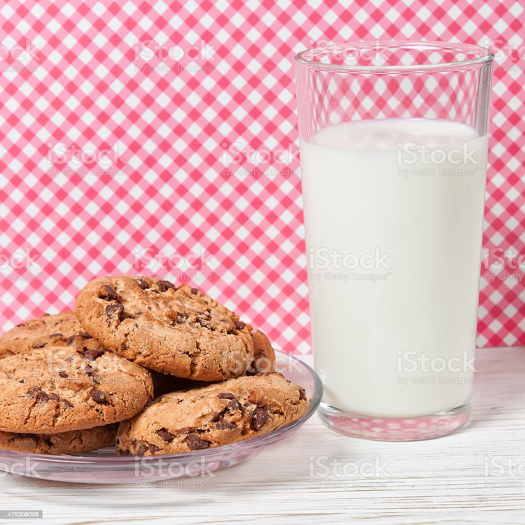Tasty cookies and glass of milk stock photo