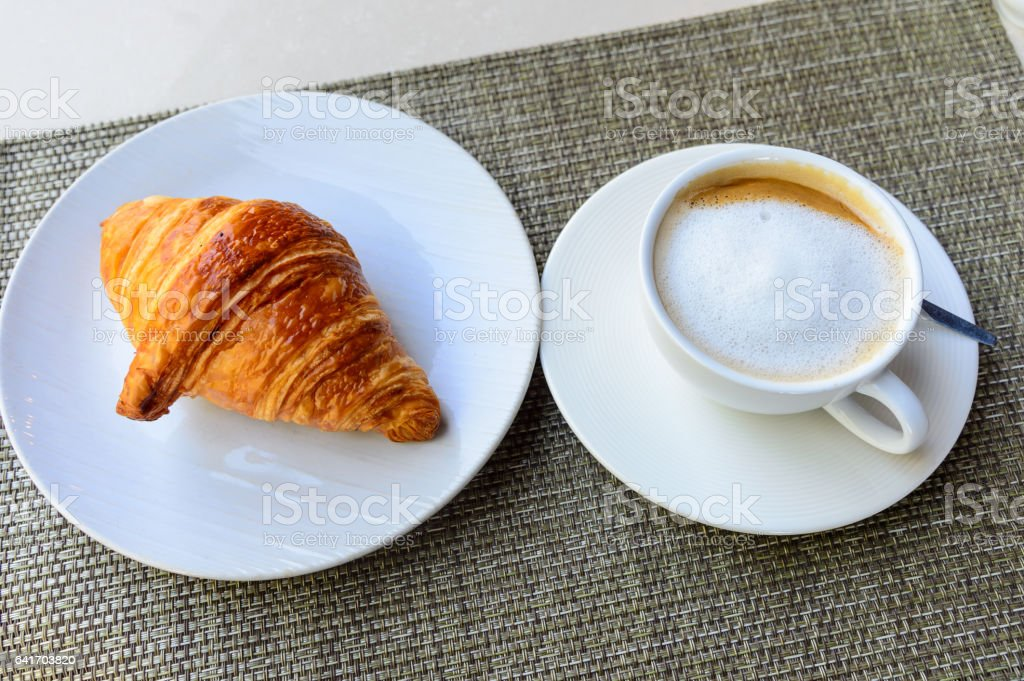 tasty croissant on the dish and coffee stock photo