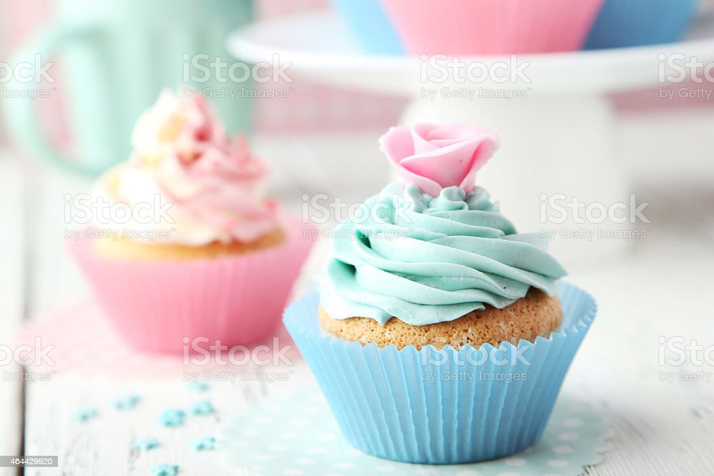 Tasty cupcake on white wooden background stock photo