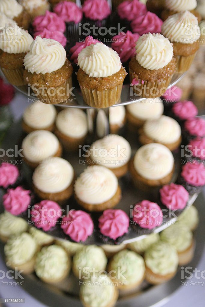 Tasty Cupcakes on 3 tier cake platter at wedding repetion royalty-free stock photo