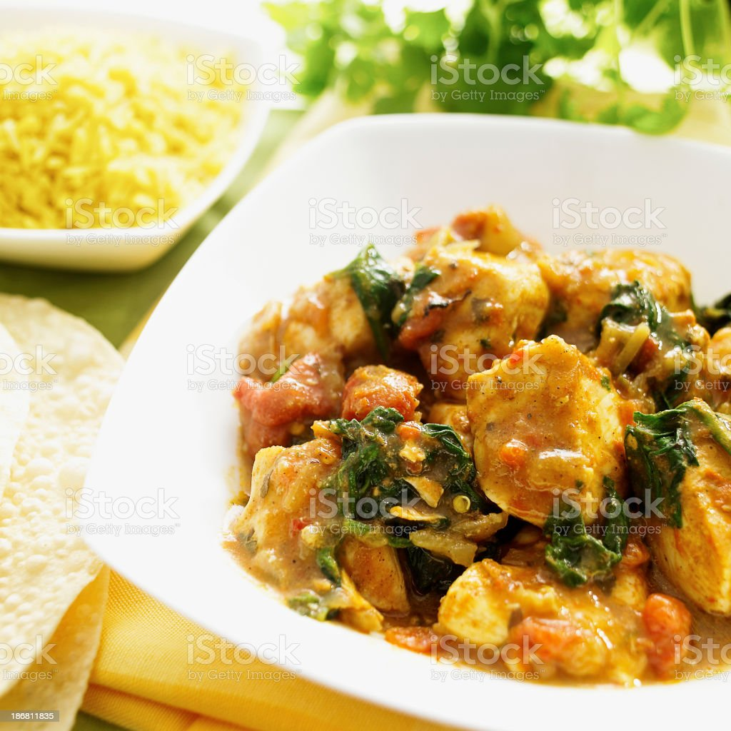 Tasty curry dish with side rice and poppadoms. stock photo