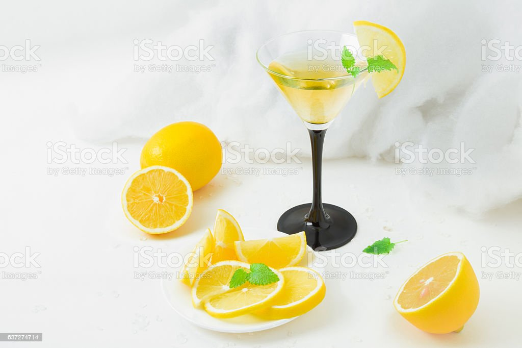 Tasty drink in the glass with lemons and mint. Freshness. stock photo