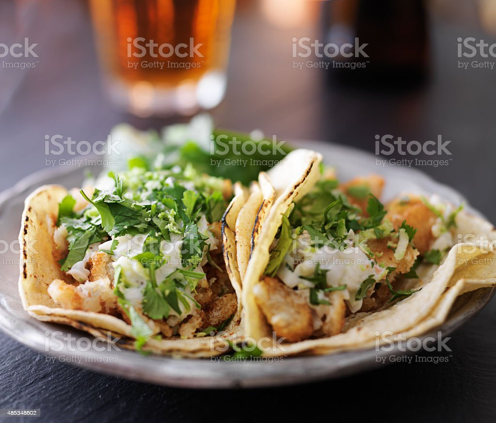 tasty fish tacos with corn tortilla stock photo