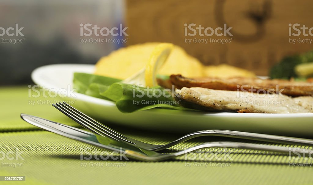 Tasty fish with lemon and vegetables royalty-free stock photo