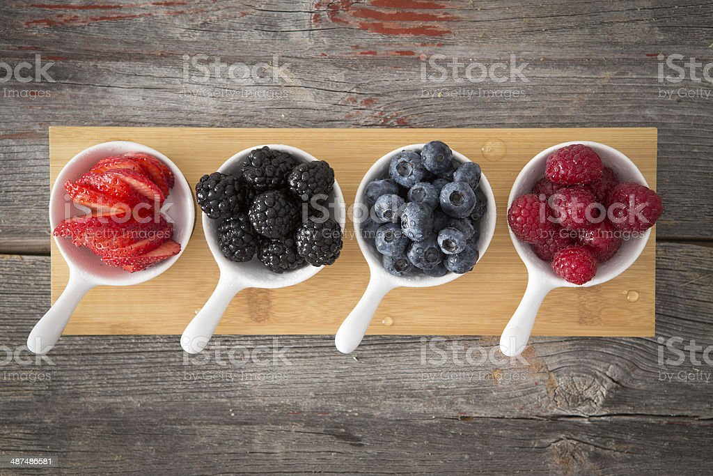 Tasty fresh autumn berries in a rustic kitchen stock photo