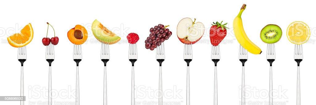 tasty fruits on forks stock photo