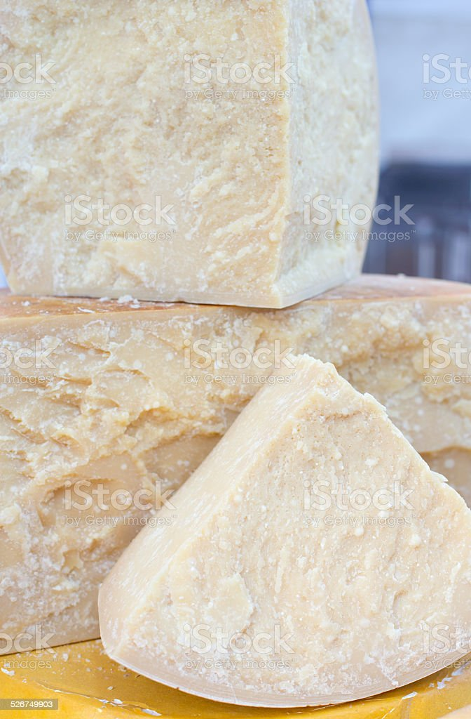 tasty great seasoned Italian cheese for sale in dairy stock photo