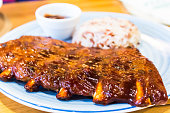 Tasty grilled barbecue ribs with rice.