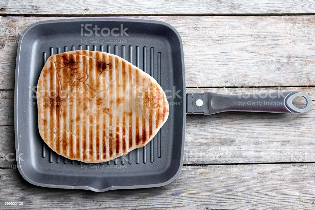 Tasty Grilled Naan Flatbread on a Square Pan stock photo