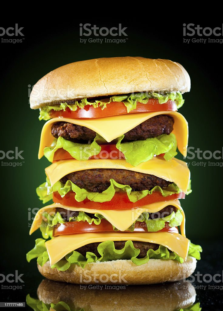 Tasty hamburger and french fries on a dark royalty-free stock photo