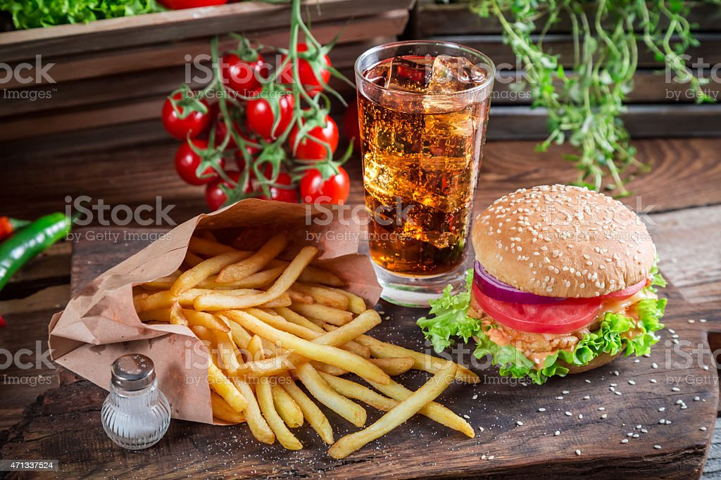 Tasty hamburger with cold drink and fries stock photo