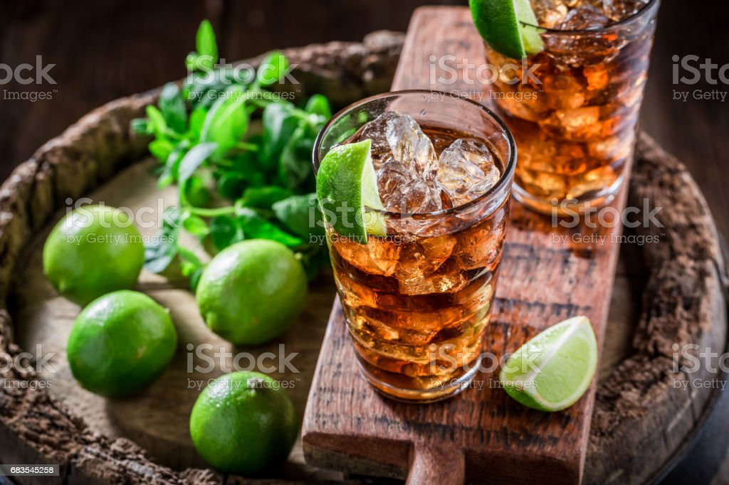 Tasty iced tea with lime and ice stock photo