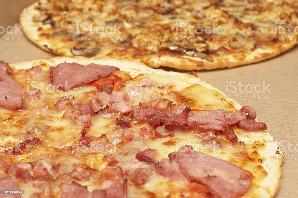 Tasty italian pizza with bacon and cheese royalty-free stock photo