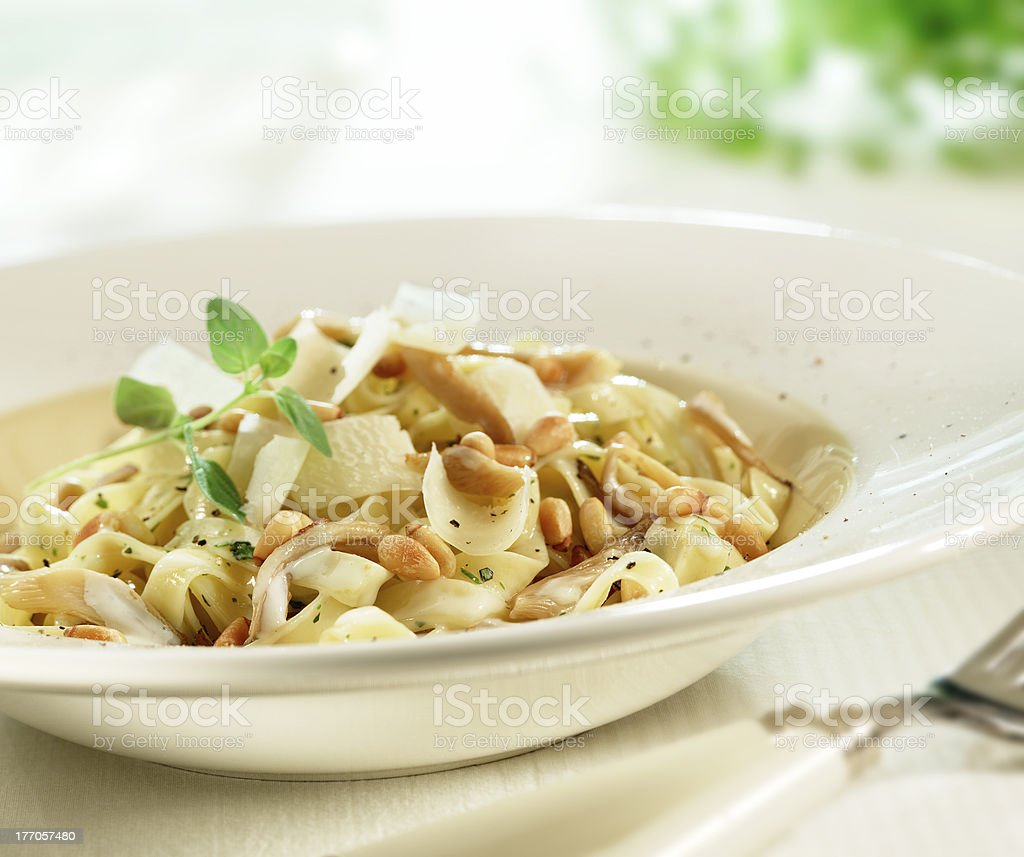 tasty italian tagliatelle with parmesan cheese and pine nuts royalty-free stock photo