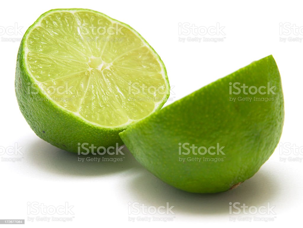tasty lime halved isolated stock photo