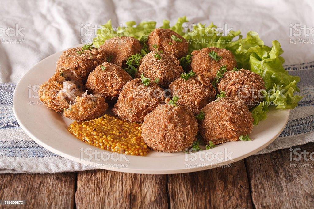 Tasty meat balls Bitterballen and mustard closeup on a plate stock photo