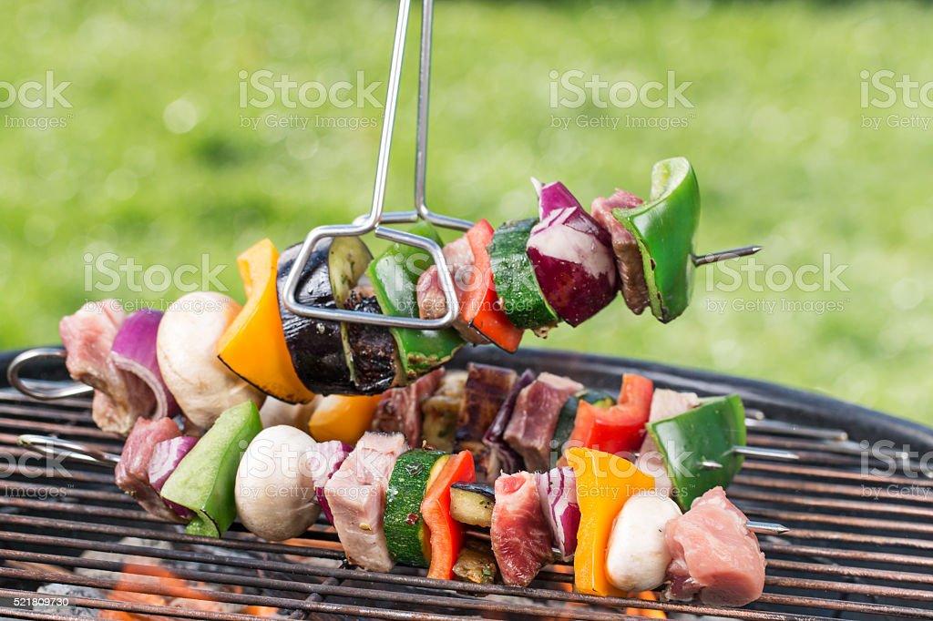 Tasty meat on garden grill stock photo