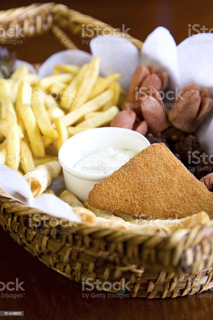 tasty nuggets with french fries stock photo