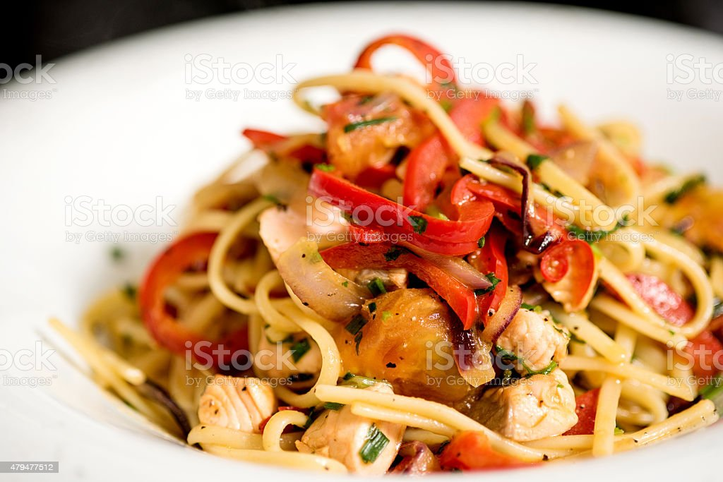 Tasty pasta with chicken. stock photo