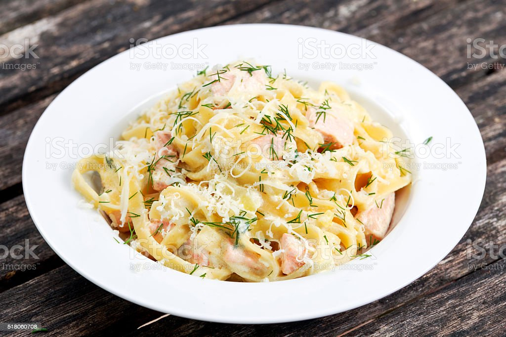 tasty pasta with salmon, dill on plate. stock photo