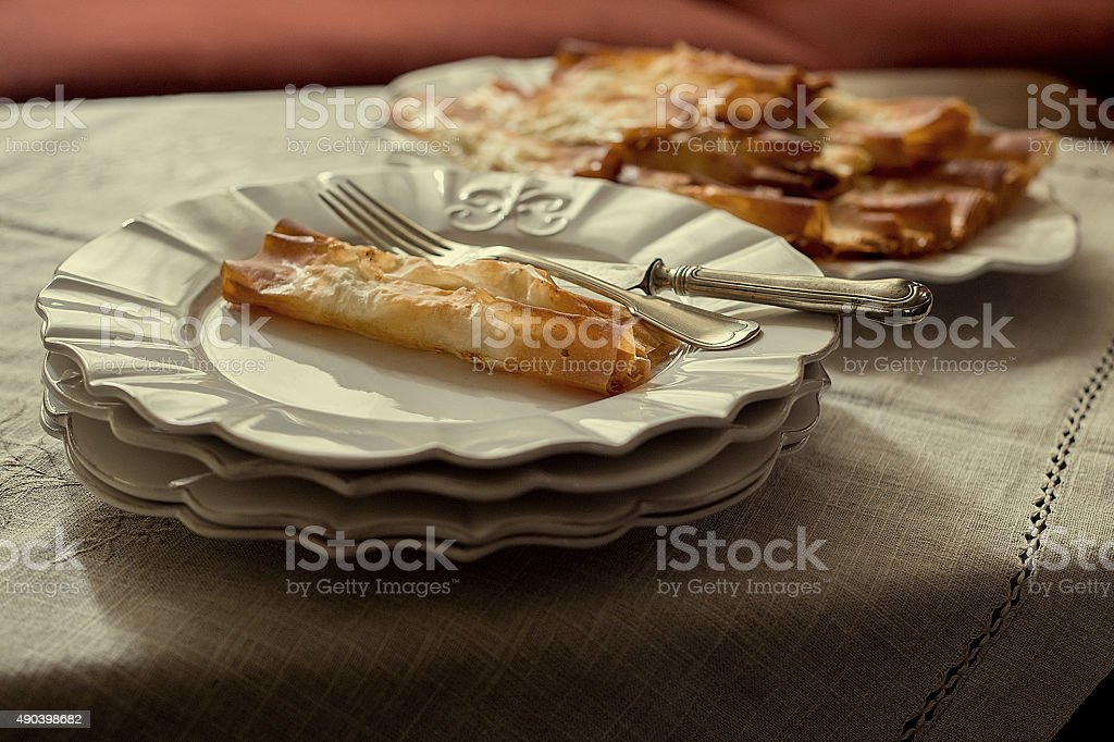 Tasty pastry served in porcelain plates, closeup shot stock photo