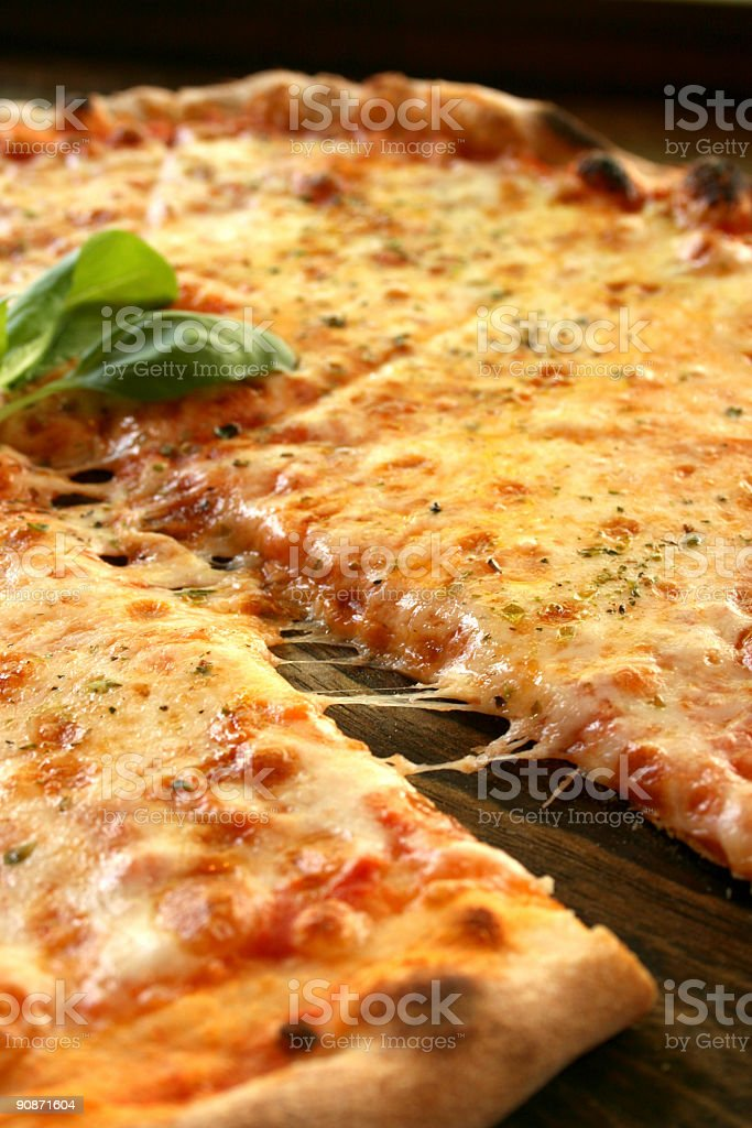 Tasty pizza margharita slice stock photo