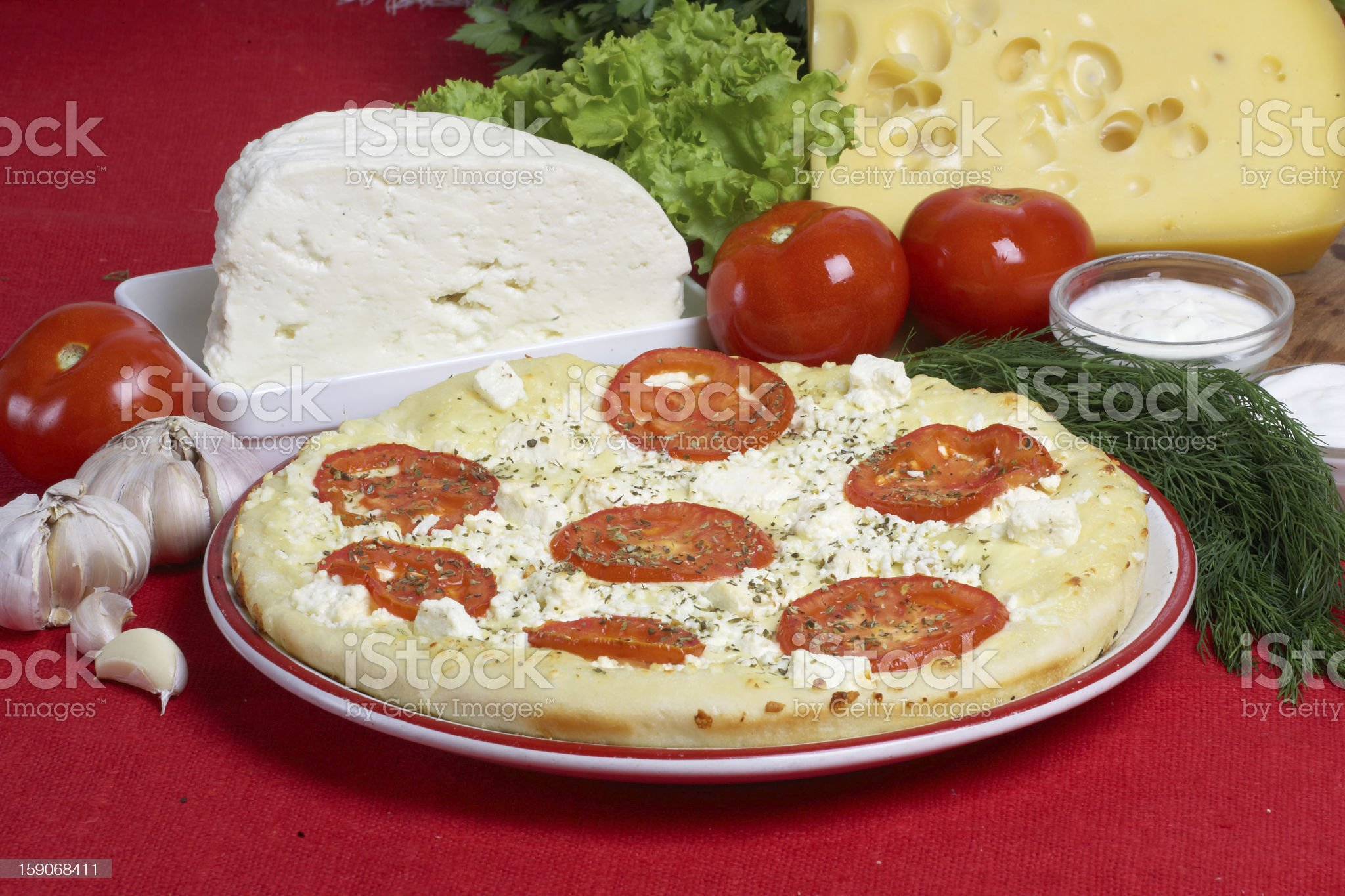 tasty pizza with tomato, onion and garlic royalty-free stock photo