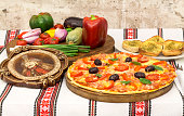 Tasty pizza with vegetables, basil, olives, tomatoes, green pepper