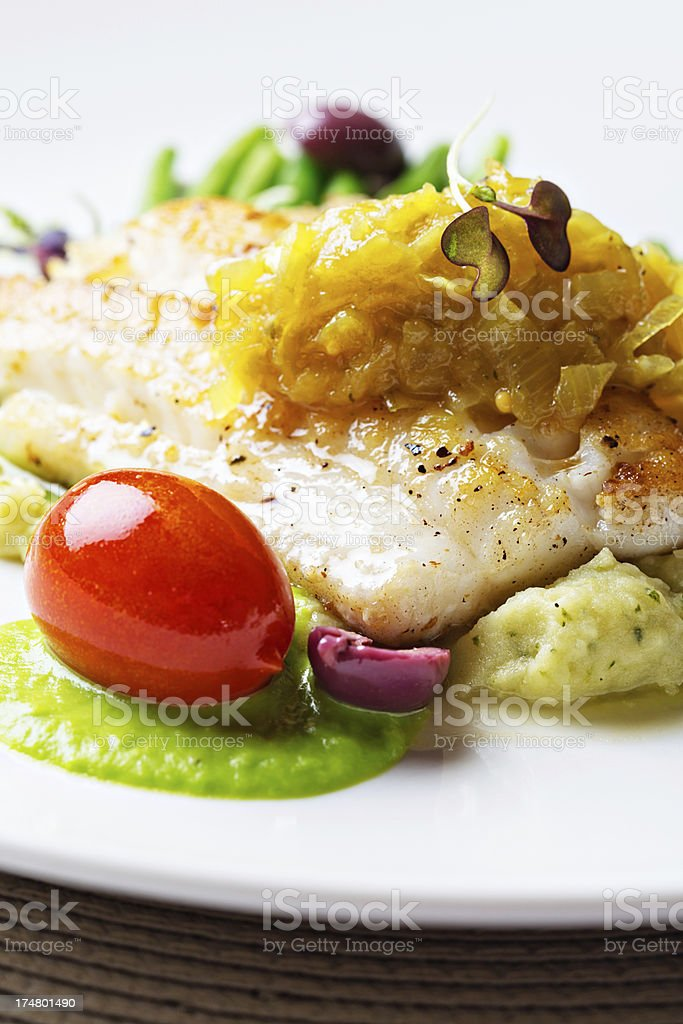 Tasty restaurant entree of grilled fish and vegetables stock photo