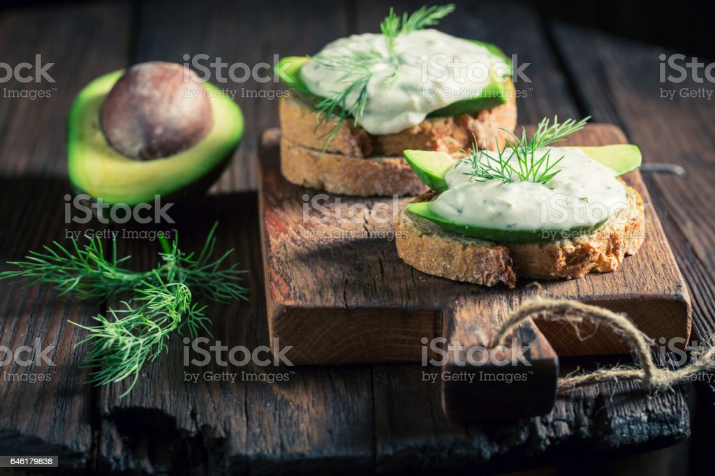 Tasty sandwich with avocado and tzatziki sauce stock photo