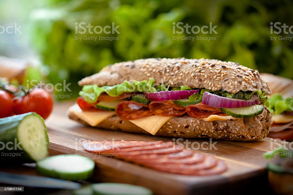tasty sandwiches on a wooden table stock photo