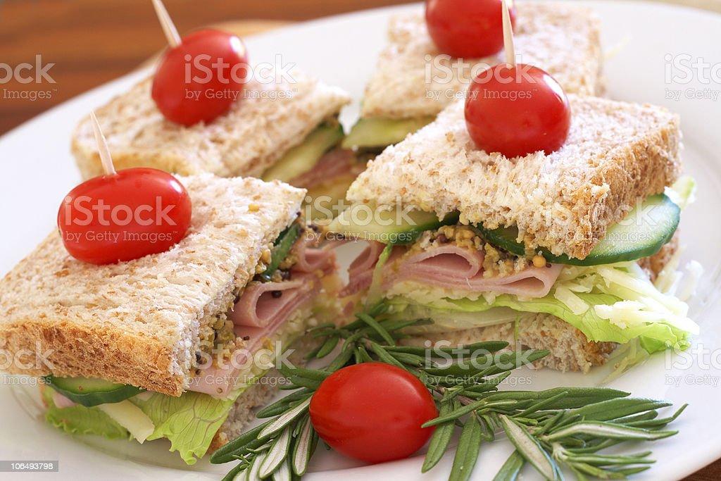 Tasty sandwiches on wholewheat bread stock photo