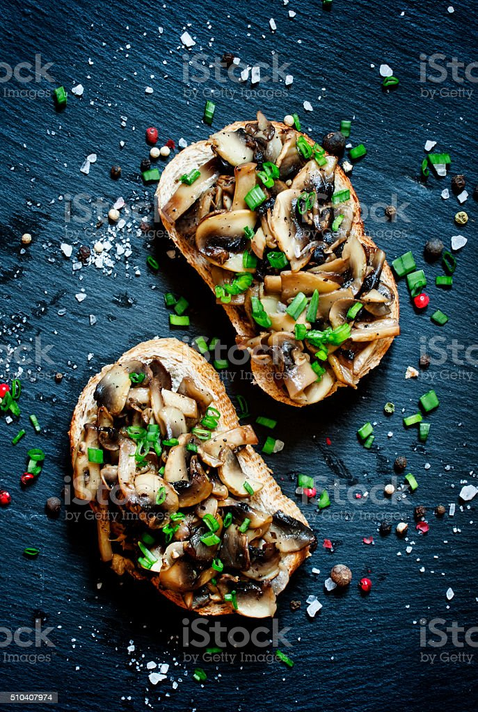 Tasty sandwiches with grilled mushrooms and green onions stock photo