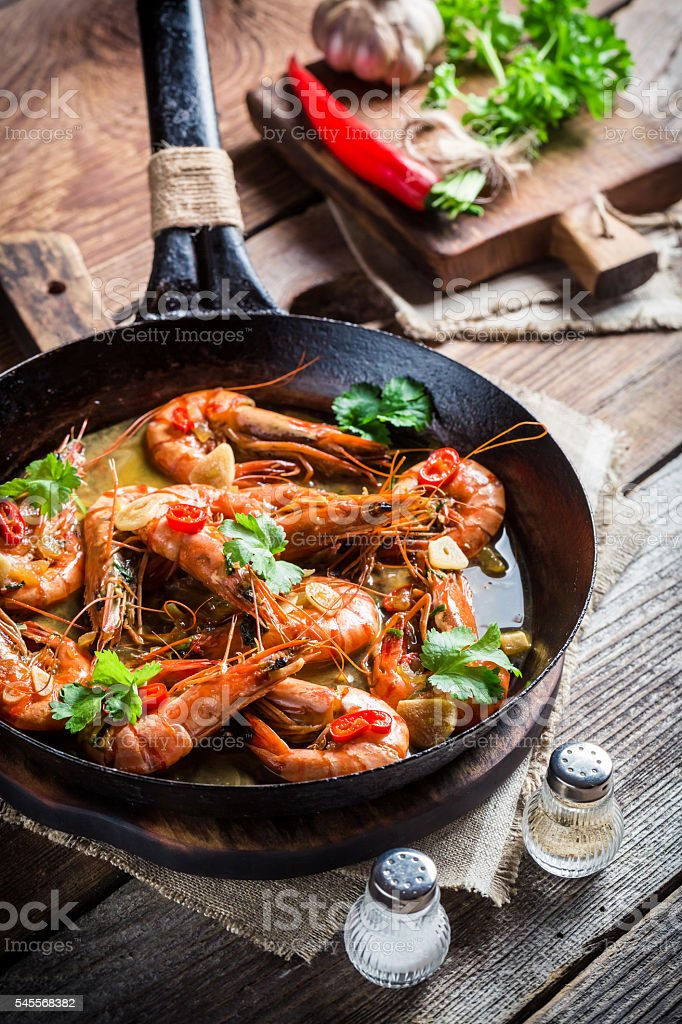 Tasty shrimps served on hot pan stock photo