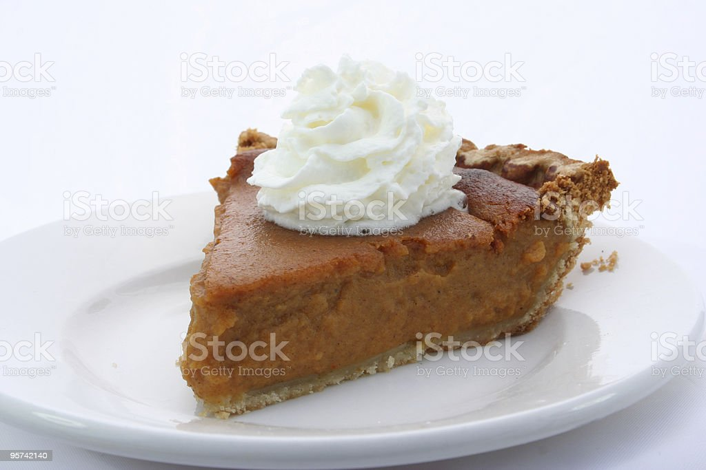 Tasty slice of pie with whipped cream royalty-free stock photo