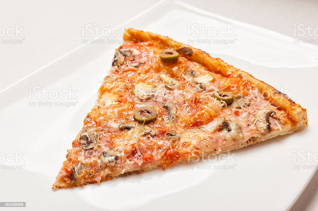 Tasty slice of piza stock photo