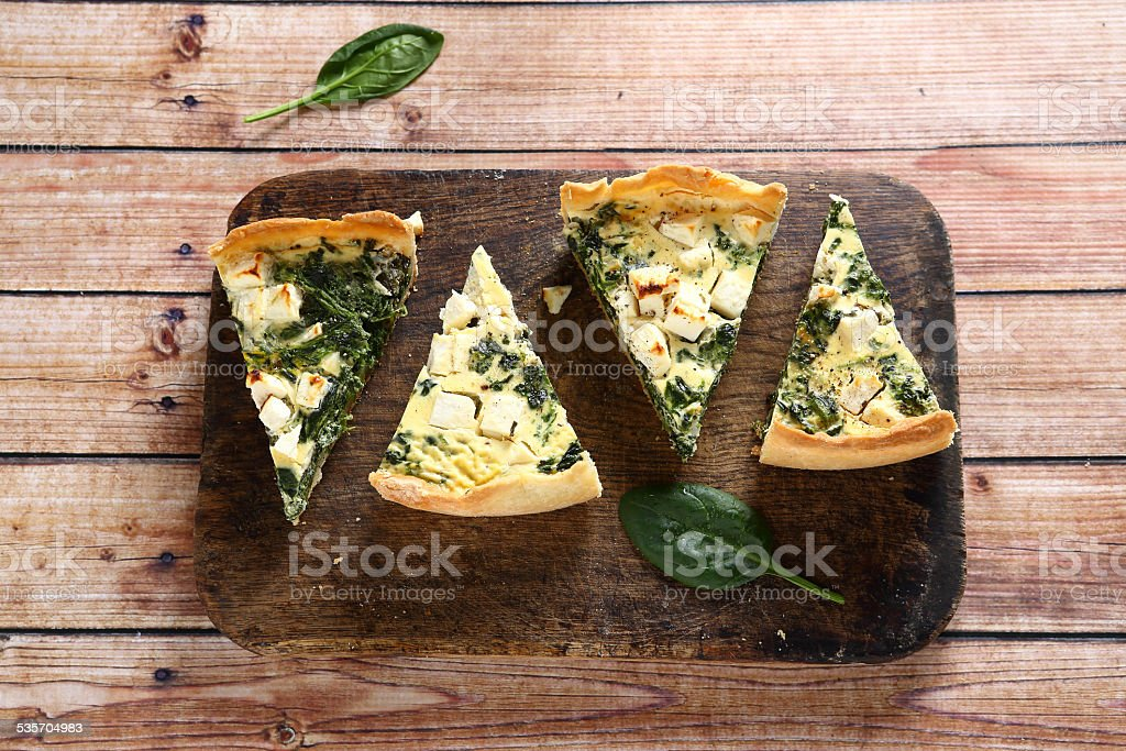 Tasty slices pie on a cutting board stock photo