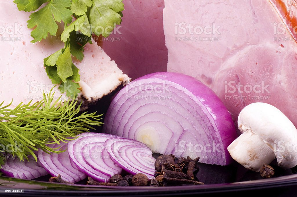 Tasty smoked meat with onion and spaces royalty-free stock photo