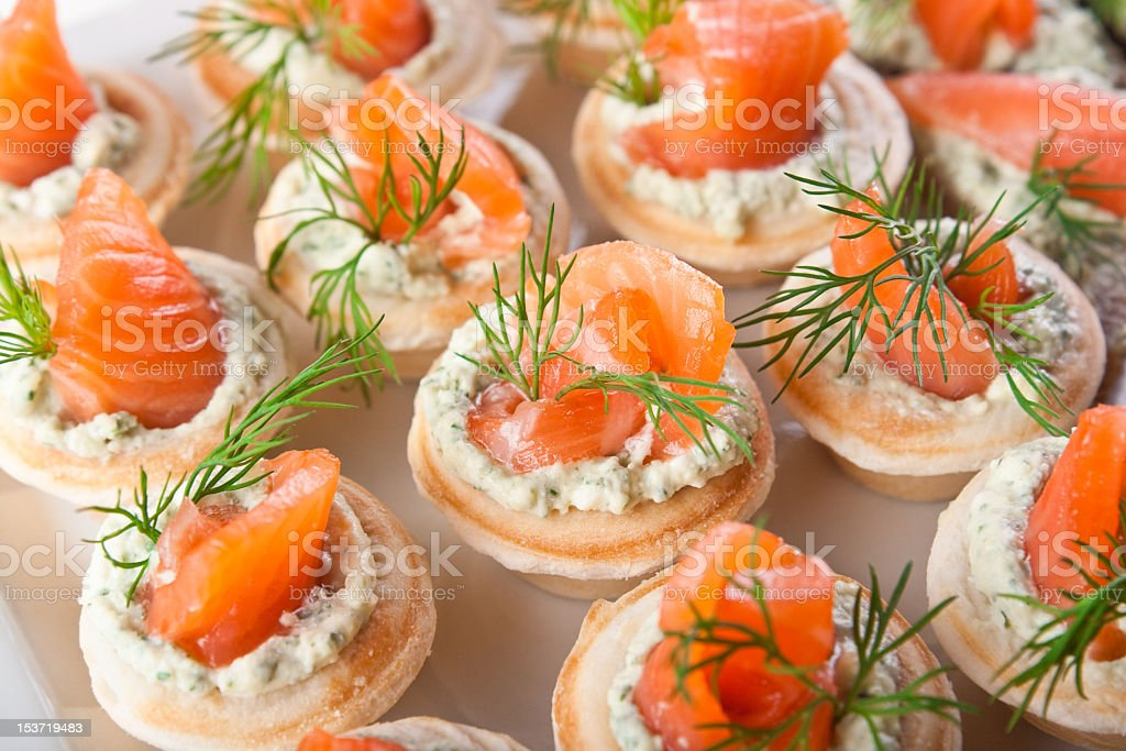 Tasty snacks with salmon and cottage filling stock photo