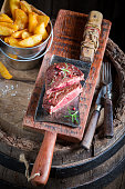 Tasty steak and chips with rosemary and salt