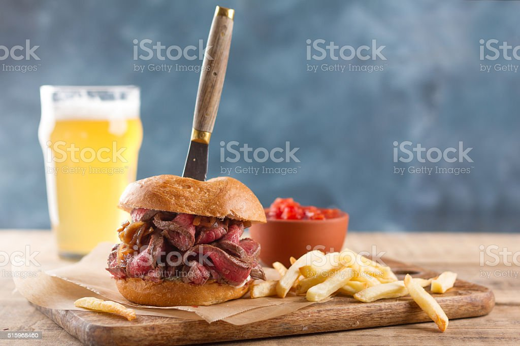 Tasty steak burger on a wooden board stock photo