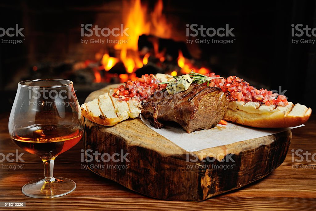 tasty steak on a background of fire stock photo