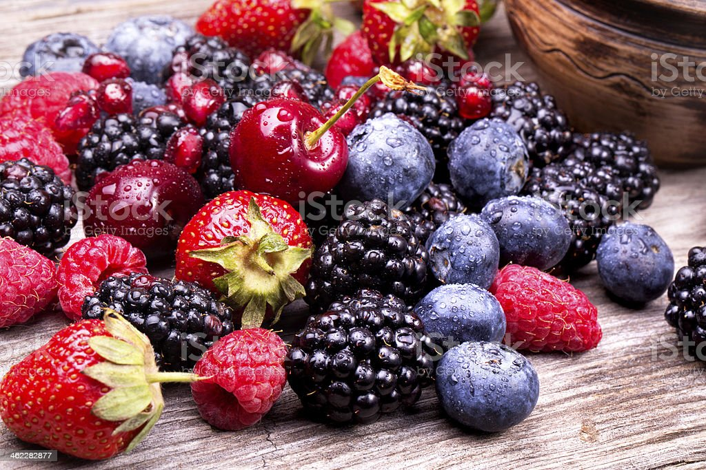 tasty summer fruits on a wooden table stock photo