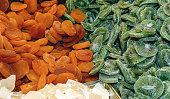 Tasty sweet mix colorful dried fruits. Kiwi, apricot.